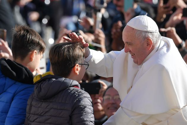 Pope Francis blesses teenagers as he arrives for the weekly general audience on November 7, 2018 at St....