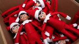 Elf on the Shelf figures are piled in a box at the company's studio Thursday, Aug. 27, 2020, in Atlanta. Thousands of suppliers routinely rely on credit insurance to cover potential losses if any of the retailers they work with can't pay for the goods they've ordered. But now insurers are scaling back on coverage because they are unwilling to take a chance on retailers that are struggling to survive during the pandemic.  Christa Pitts, founder and co-CEO of The Lumistella Company, which produces toys, books and other products under the Elf on the Shelf and Elf Pets brands, says her retail orders were covered 100% before the pandemic. Now, only 50% are covered, forcing her to rethink who she will sell to. (AP Photo/John Bazemore)