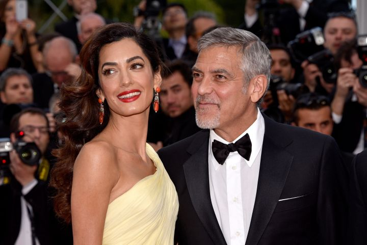George and Amal Clooney attend the