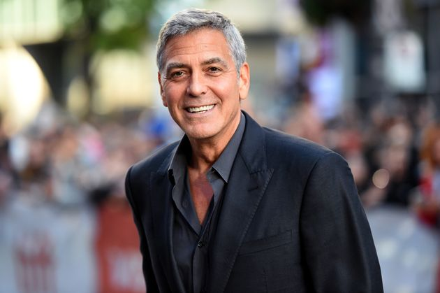 "After the crash, George Clooney remembers that ""all these people came and stood over me and just..."
