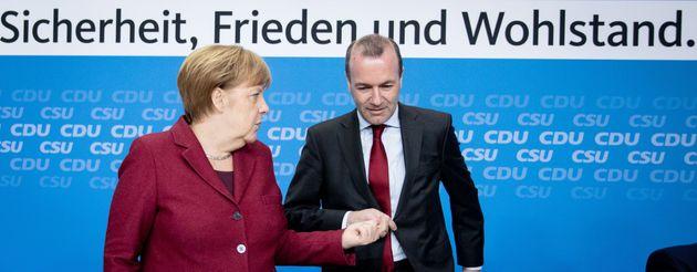 25 March 2019, Berlin: Federal Chancellor Angela Merkel (CDU) and Manfred Weber, EPP top candidate, participate...