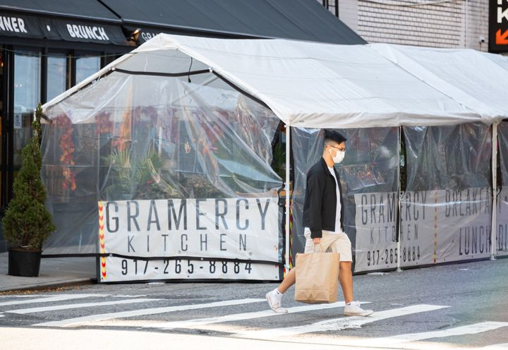 An outdoor tented restaurant area in New York City.