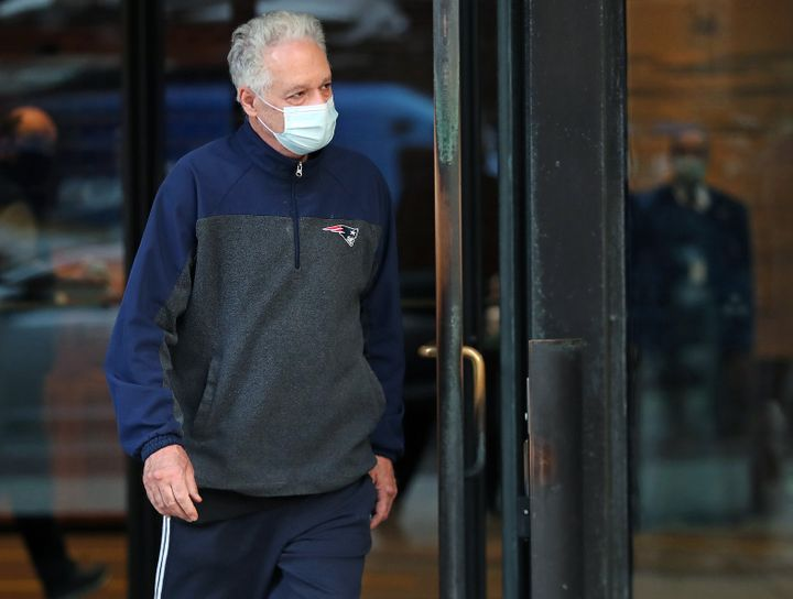 Former Harvard University fencing coach Peter Brand leaves a Boston courthouse on Monday after being arraigned and freed on b