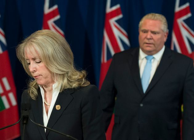Ontario Minister of Long-Term Care Merrilee Fullerton answers questions with Premier Doug Ford at Queen's...