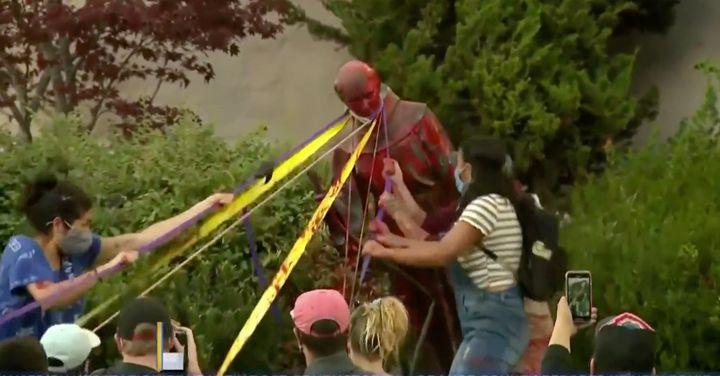 Protesters pull down a statue of St. Junípero Serra at Mission San Rafael Arcángel in San Rafael, California, o