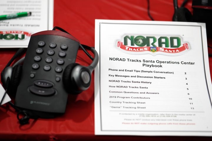 In this 2019 file photo, a playbook sits next to a telephone set up in the NORAD Tracks Santa center at Peterson Air Force Ba