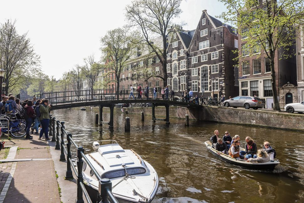 The city of Amsterdam, in the Netherlands, is trying to create an economy that can meet people's needs without causing irreparable damage to the climate and nature. Credit: Nicolas Economou/NurPhoto via Getty Images