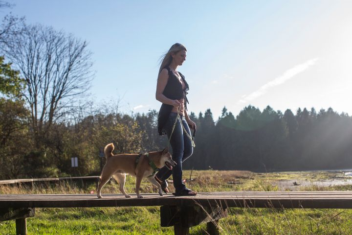 Juli-Ann Aaron walks with her dog Pumpkin near her home in Port Moody, B.C.