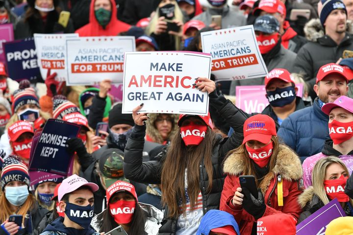 """Supporters listen as President Donald Trump speaks at a """"Make America Great Again"""" rally at Oakland County International Airp"""