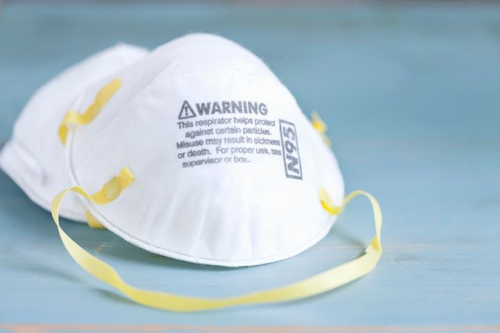 An N95 mask is shown in a stock photo.