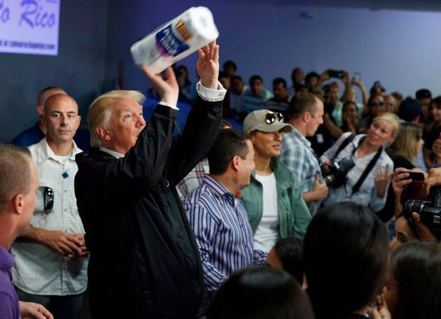 On Oct. 3, 2017, U.S. President Donald Trump tosses paper towels into a crowd in Guaynabo, Puerto Rico,...
