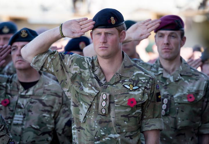 Harry joins British troops and service personnel as well as International Security Assistance Force personnel and civilians as they gather for a Remembrance Sunday service at Kandahar Airfield on Nov. 9, 2014, in Afghanistan.