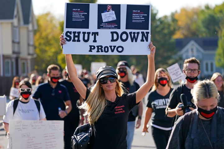 Paris Hilton, centre, leads a protest outside Provo Canyon School in Provo, Utah on Oct. 9, 2020.