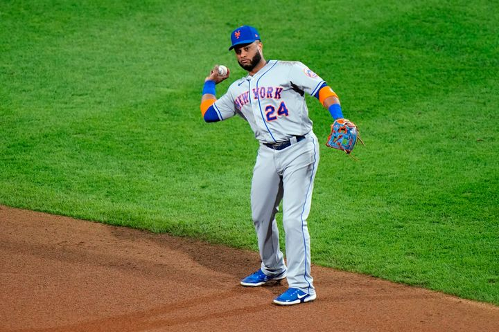 New York Mets second baseman Robinson Cano throws to first after fielding a ground out by Philadelphia Phillies' Didi Gregori