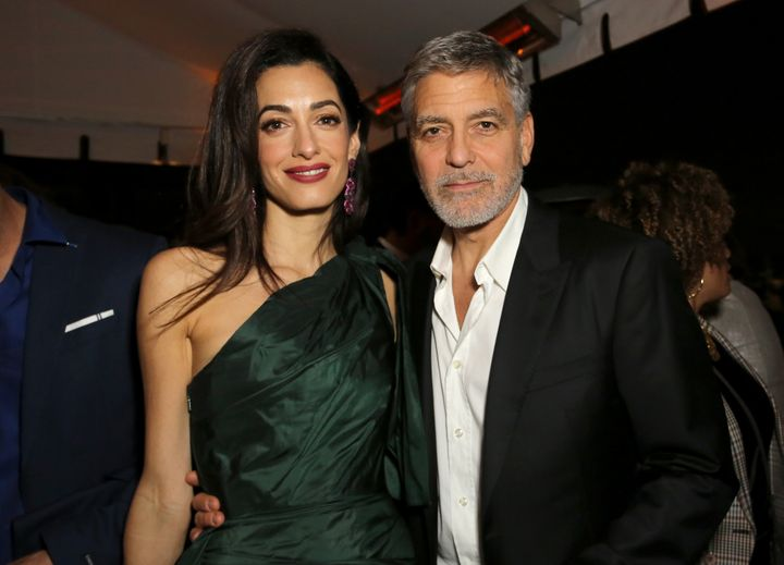 "Amal and George Clooney at the premiere of ""Catch-22"" on May 7, 2019."