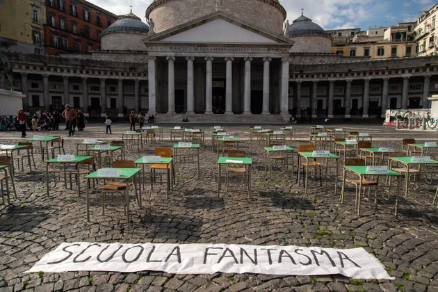 NAPLES, ITALY - NOVEMBER 13: Empty school desks and a banner that reads: