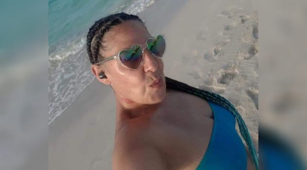 Antoinette Traboulsi is photographed on a beach in an undated Facebook photo. The 52-year-old woman workedas...