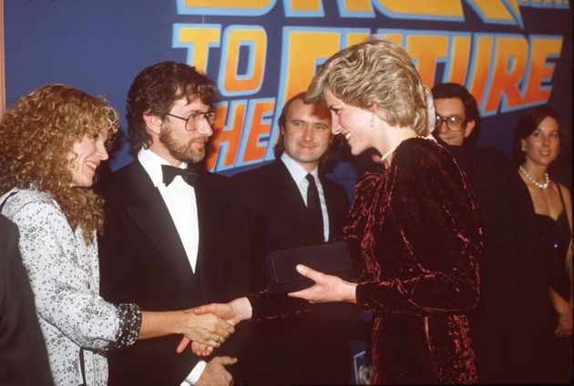 Princess Diana says hello to Steven Spielberg and his then-wife Amy Irving (as rocker Phil Collins looks...