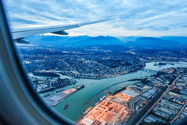 View from airplane window with top view of Vancouver, B.C.