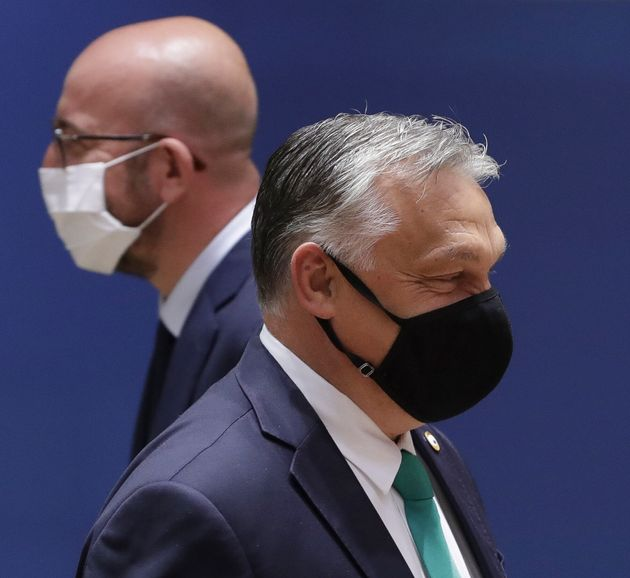 European Council President Charles Michel, left, walks past Hungary's Prime Minister Viktor Orban during...