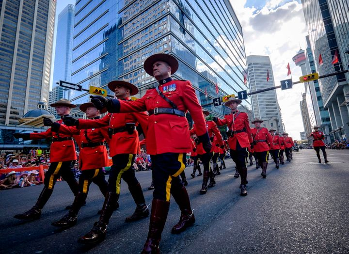RCMP members march during the Calgary Stampede parade in Calgary, on July 7, 2017.