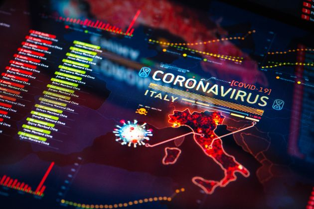 Coronavirus (COVID-19) Outbreak in Italy Statistics close-up on digital display. Quarantine