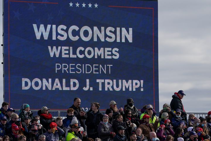 Supporters wait for President Donald Trump to speak at an Oct. 30 campaign rally at the Austin Straubel Airport in Green Bay,