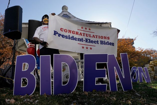 Joe Biden supporters in Milwaukee react to the announcement on Nov. 7 that Biden defeated Trump in the...
