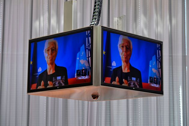 European Central Bank (ECB) President Christine Lagarde is seen on a screen as she speaks during a meeting...