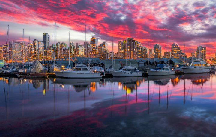In this undated file photo, yachts sit in a marina at Coal Harbour in Vancouver. Canadians overwhelmingly back a wealth tax on fortunes above $20 million, a new Abacus poll has found.