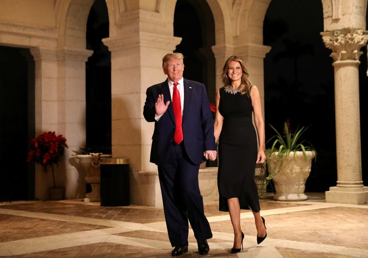 President Donald Trump and first lady Melania Trump arrive to their Christmas Eve party at Trump's Mar-a-Lago resort in Palm