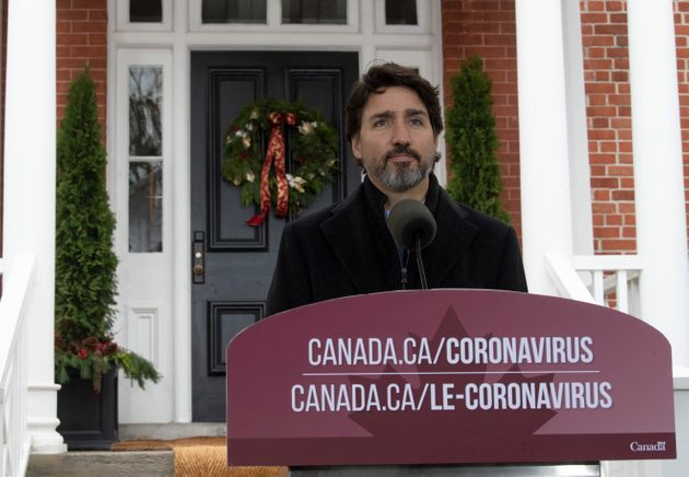 Prime Minister Justin Trudeau speak to the media about the COVID-19 virus outside Rideau Cottage in Ottawa...