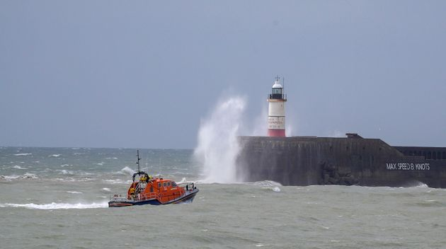 A RNLI lifeboat continues the search for missing two fishermen who went missing near Seaford, Sussex, after their fishing boat sank.