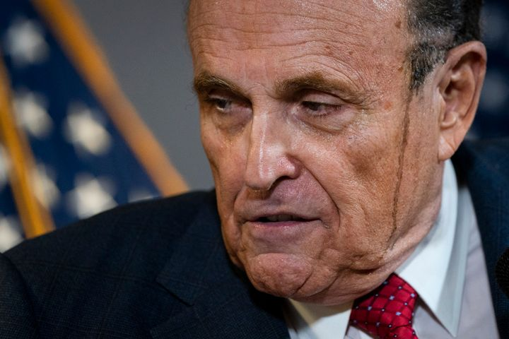 Rudy Giuliani speaks to the press about various lawsuits related to the 2020 election at the Republican National Committee he