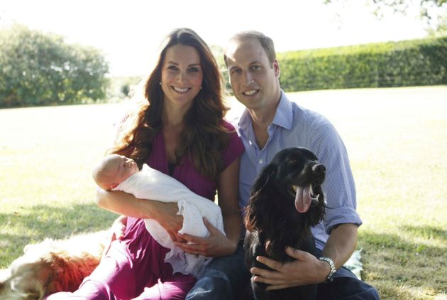 Prince William and Kate Middleton with newborn Prince George and their dog Lupo at the Middleton family home in August 2013.
