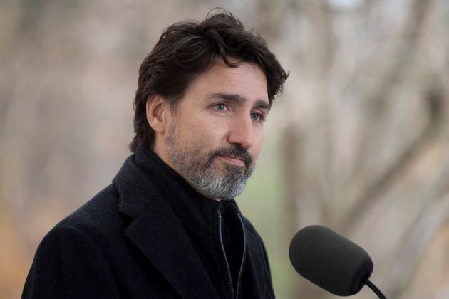Prime Minister Justin Trudeau pauses after responding to a question about the holidays during a news...