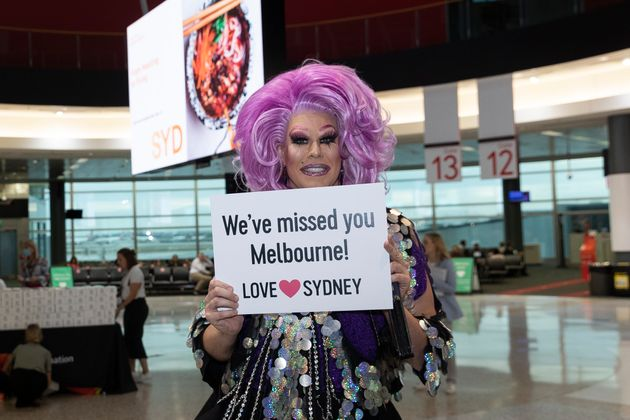 Drag Queen Penny Tration sets up to greet arrivals at Sydney Airport on on November 23, 2020 in Sydney,