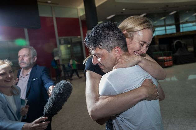 Genivieve Wild and Adam Deguara reunite after five months apart at Sydney Airport on November 23, 2020...
