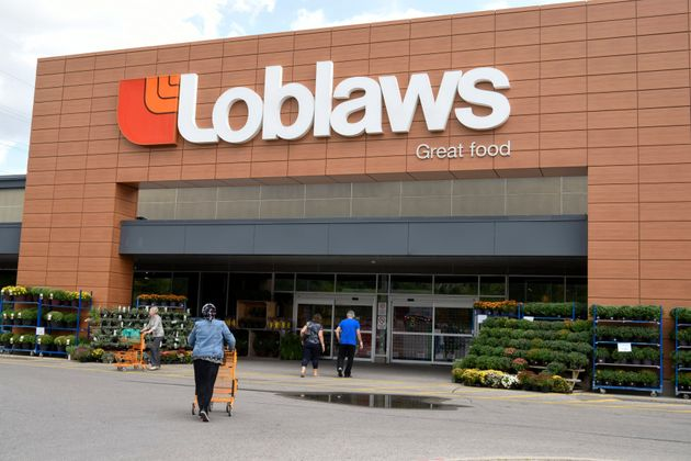 People walk toward a Loblaws store in Toronto in 2018. The Canadian grocery chain has signed a multi-year...