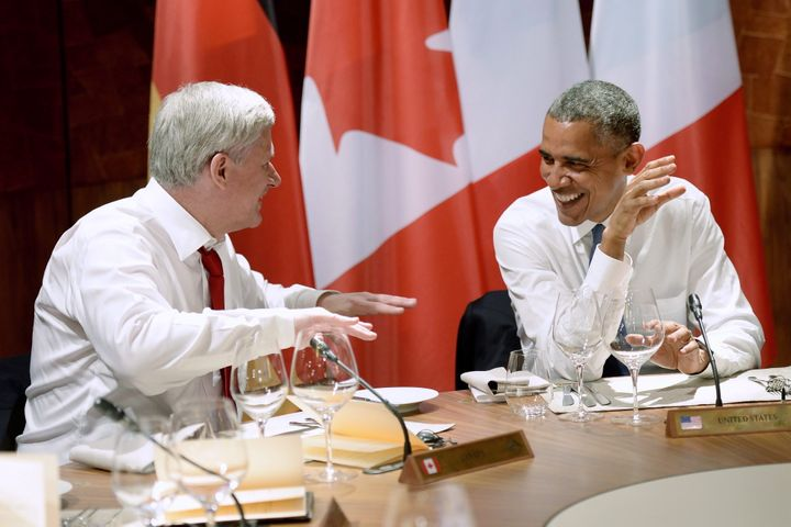 Stephen Harper jokes around as he talks with Barack Obama during dinner at the G7 meeting at Schloss Elmau near Garmisch, Germany on June 7, 2015.