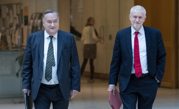 Jeremy Corbyn and the party's chief whip Nick Brown walk through Portcullis House in