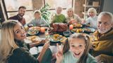 Cheers! Photo of big family sit feast dishes table roasted turkey multi-generation relatives shooting selfies showing v-sign raising wine glasses in living room indoors