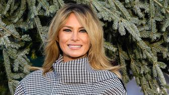 US First Lady Melania Trump receives the White House Christmas Tree at the White House in Washington, DC, on November 23, 2020. (Photo by NICHOLAS KAMM / AFP) (Photo by NICHOLAS KAMM/AFP via Getty Images)