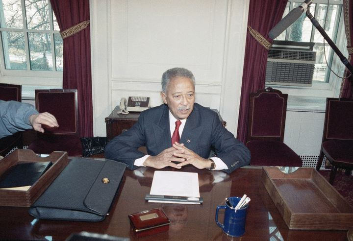 Former Mayor David Dinkins tries out his new desk on Jan. 1, 1990 at City Hall in New York prior to his inauguration ceremony
