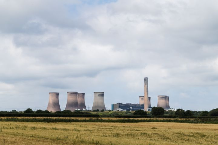 Fiddlers Ferry power station behind a field of wheat in Cheshire, England seen in August 2020.