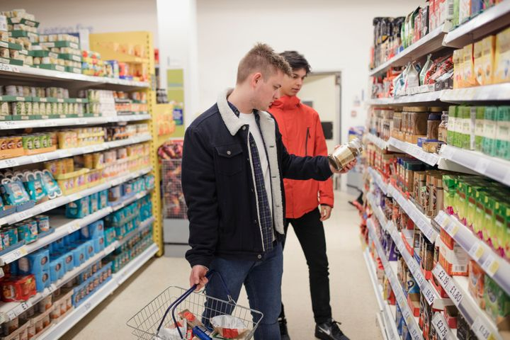 Two young men shops in a British supermarket in Newcastle-upon-Tyne.