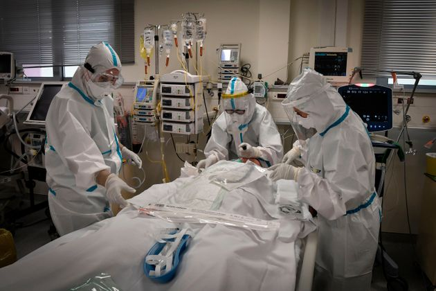 Nurses attend to a patient suffering form the novel coronavirus, Covid-19, in the Intensive Care Unit (ICU) at the Voula (Asklepeion) hospital located in an Athens' southern suburb on November 20, 2020. - The Greek ministry of health has announced the requisition of private hospitals in Thessaloniki on November 19, 2020 as the number of Covid-19 cases in the city is the highest in Greece, facing a second wave of the covid-19 pandemic caused by the novel coronavirus. (Photo by LOUISA GOULIAMAKI / AFP) (Photo by LOUISA GOULIAMAKI/AFP via Getty Images)