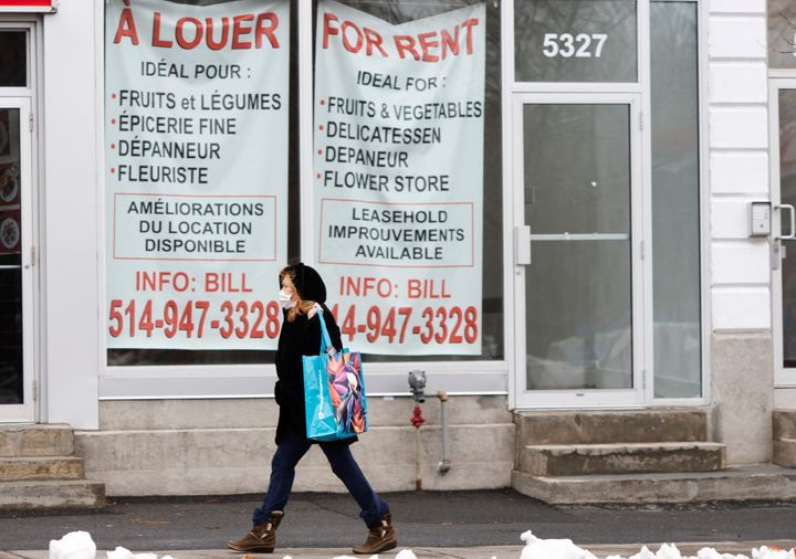 A pedestrian walks past a vacant storefront as the COVID-19 pandemic continues to impact small businesses on Nov. 23, 2020 in Montreal.