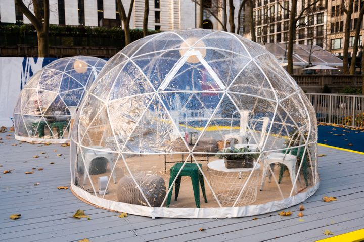 Igloo dining tents are set up at Bryant Park as New York City follows restrictions imposed to slow the spread of coronavirus.
