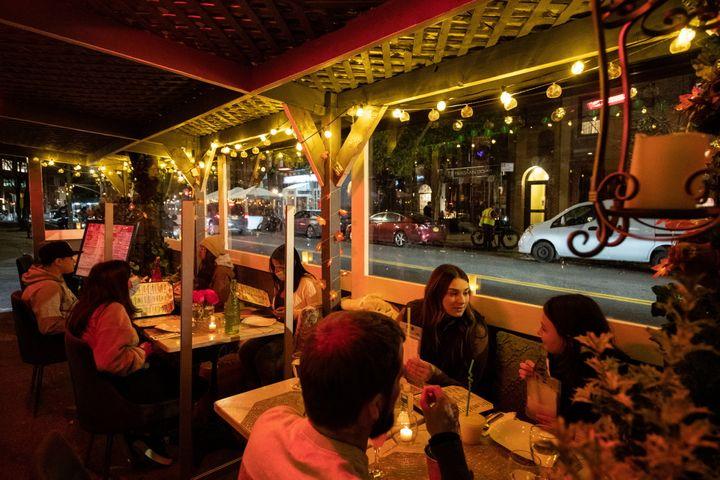 People enjoy outdoor dining on Nov. 21 at Sveta, a New York City restaurant, as the spread of the coronavirus disease continues.
